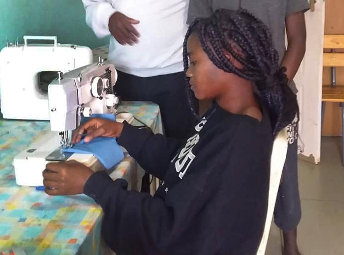 Zimbabwe orphan pays it forward during pandemic